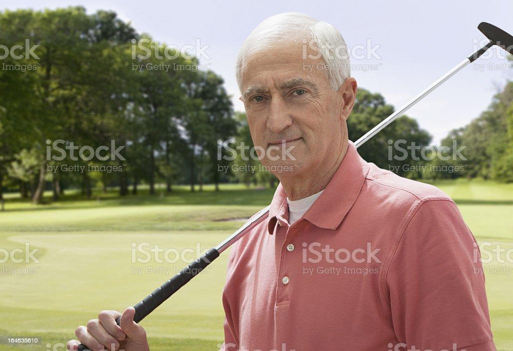 Portrait of senior man holding golf club royalty-free stock photo