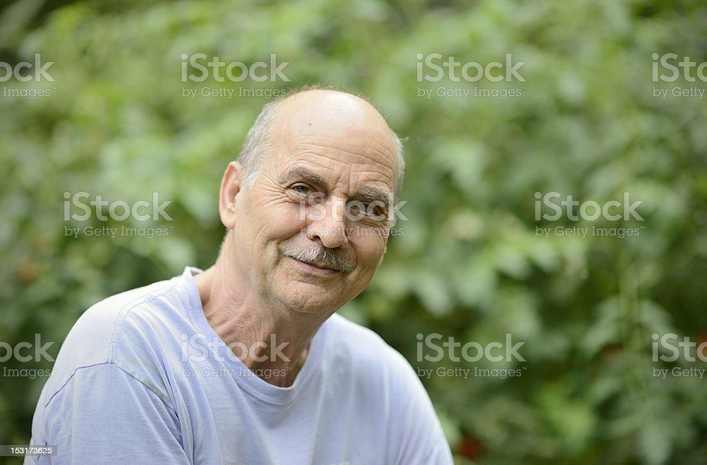Portrait of Senior Man in Garden Setting royalty-free stock photo