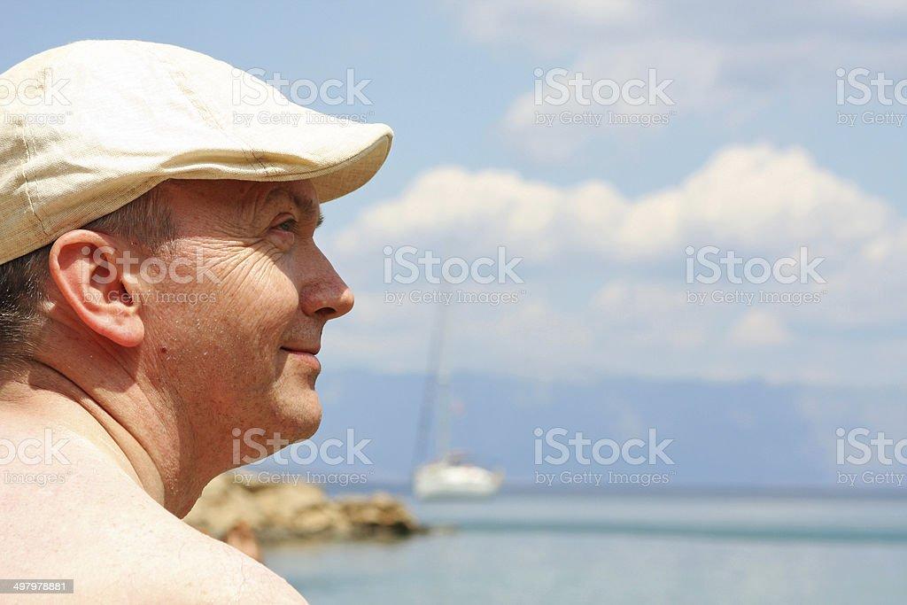Portrait of senior man on the beach. stock photo
