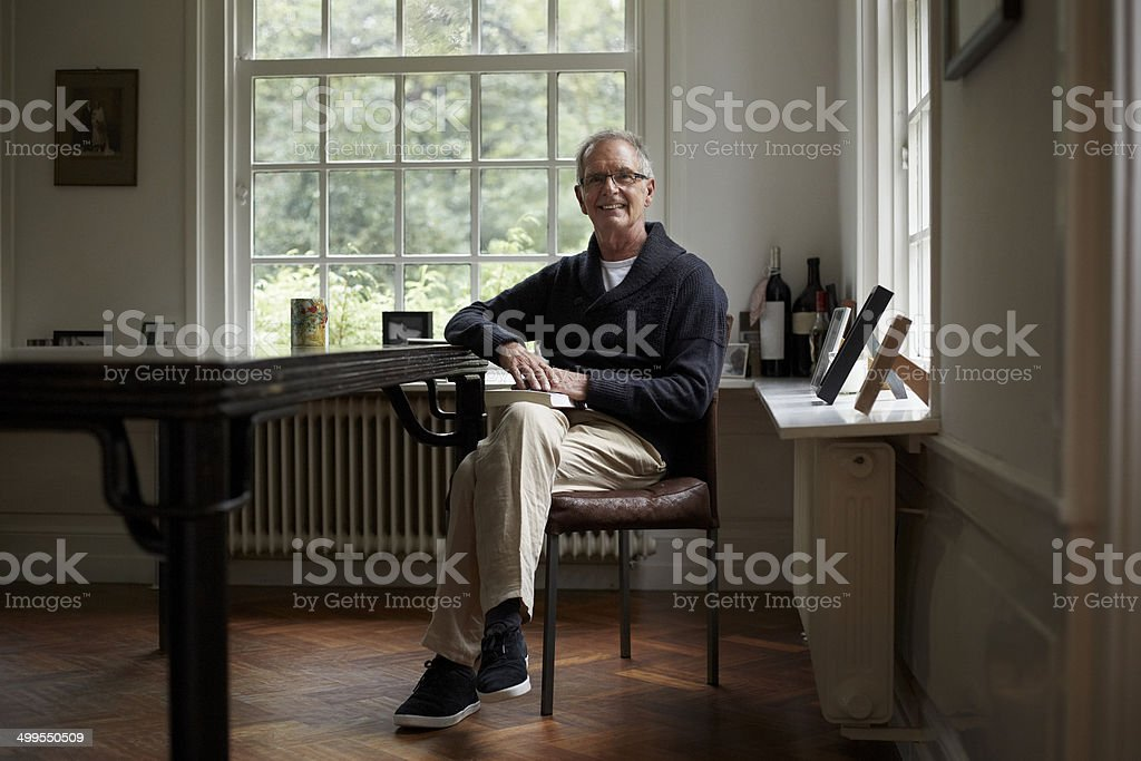 Portrait of senior man sitting in cottage stock photo
