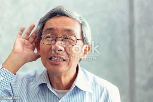1029343276 istock photo Portrait of senior man to trying hear something sound around him 970031544