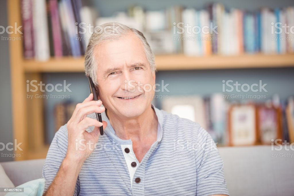 Portrait of senior man using mobile phone stock photo