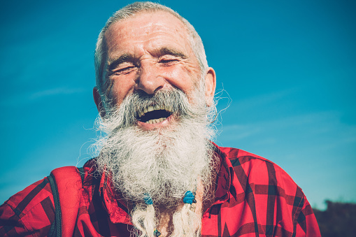 Portrait of Senior Man with White Beard and Moustaches Hiking in Southern Julian Alps, Europe