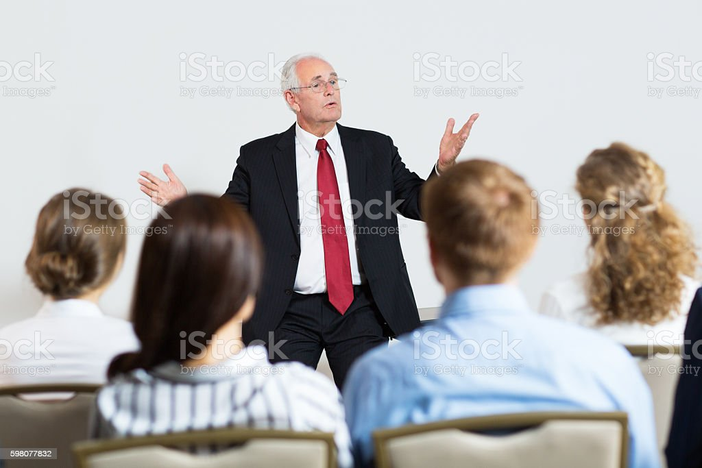 Portrait of Senior Manager Explaining Idea to His Young Colleagu stock photo