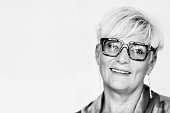 Portrait of senior manager woman in office, black and white.