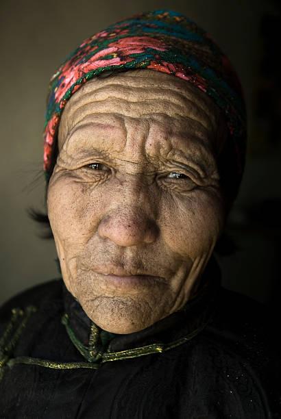 porträt von senior mongolische frau - rawpixel stock-fotos und bilder