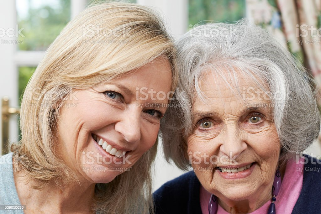 Portrait Of Senior Mother And Adult Daughter stock photo