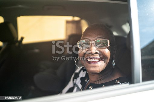 Portrait of senior passenger looking at camera