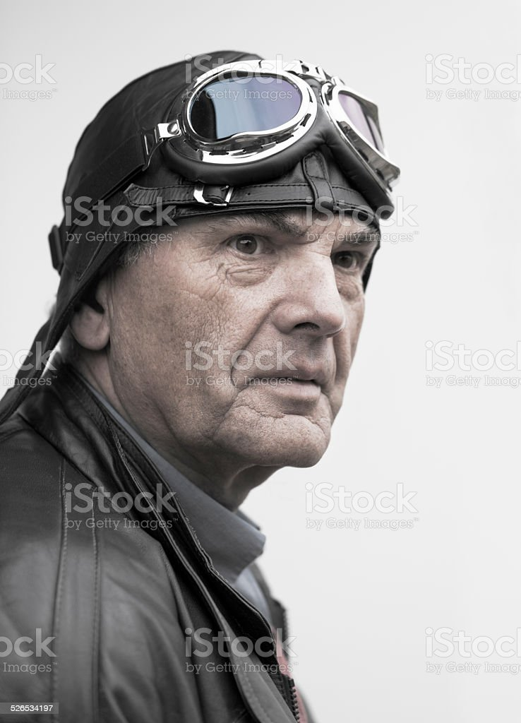 Portrait of senior pilot in desaturated retro style stock photo