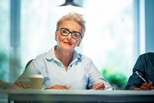 Portrait Of Senior Professional Working In Office Stock Photo - Download Image Now