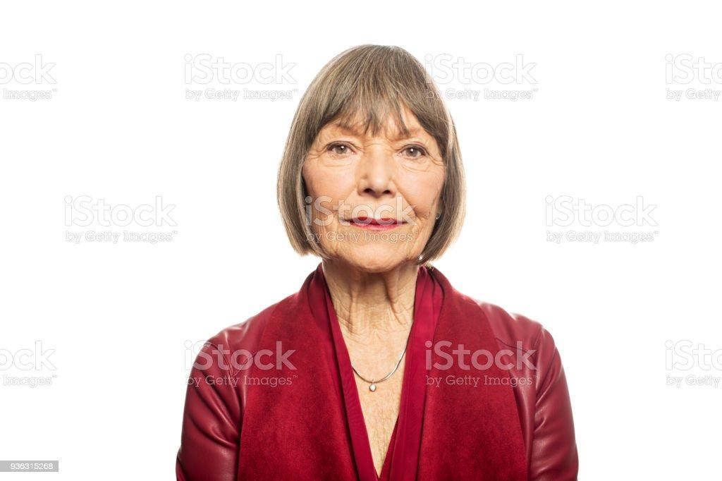 Portrait of senior woman against white background royalty-free stock photo