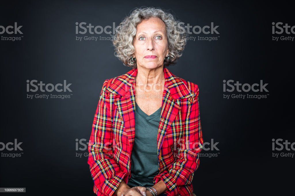 Portrait of senior woman in red plaid shirt stock photo