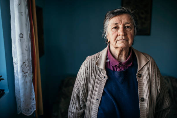 Portrait of senior woman looking at camera stock photo