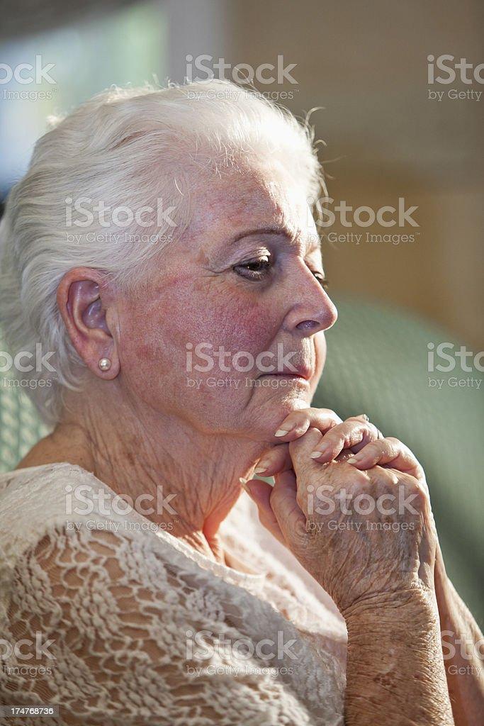 Portrait of senior woman thinking stock photo