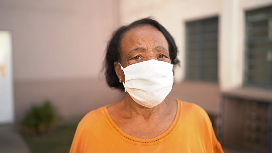 Portrait of senior woman wearing face mask