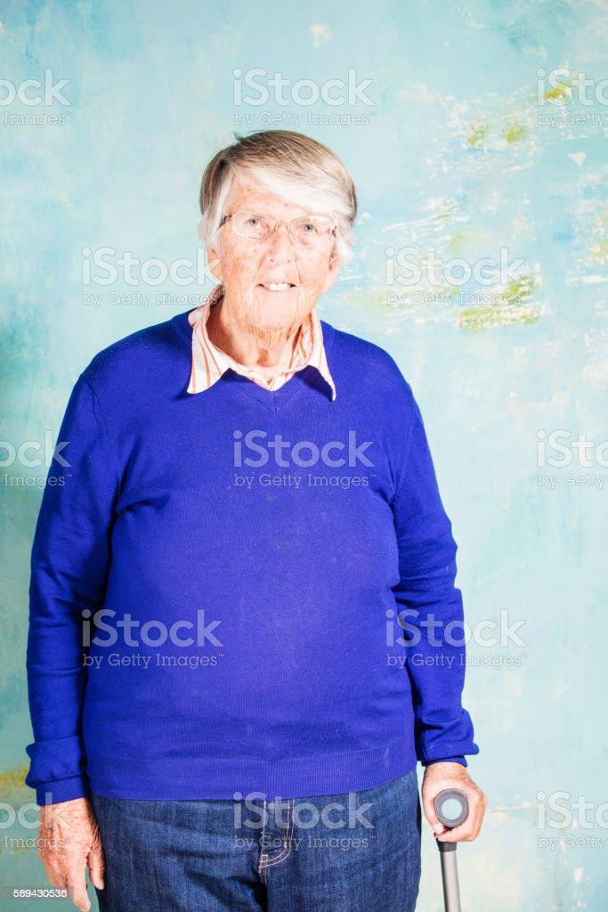 Portrait of senior woman with cane stock photo