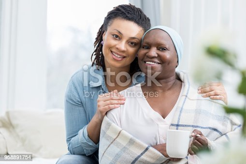 932074776istockphoto Portrait of senior woman with her adult daughter 958891754