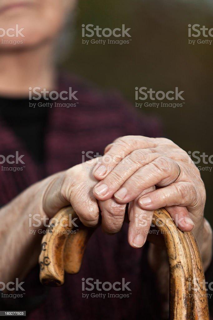 Portrait of senior woman with walking sticks, selective focus royalty-free stock photo