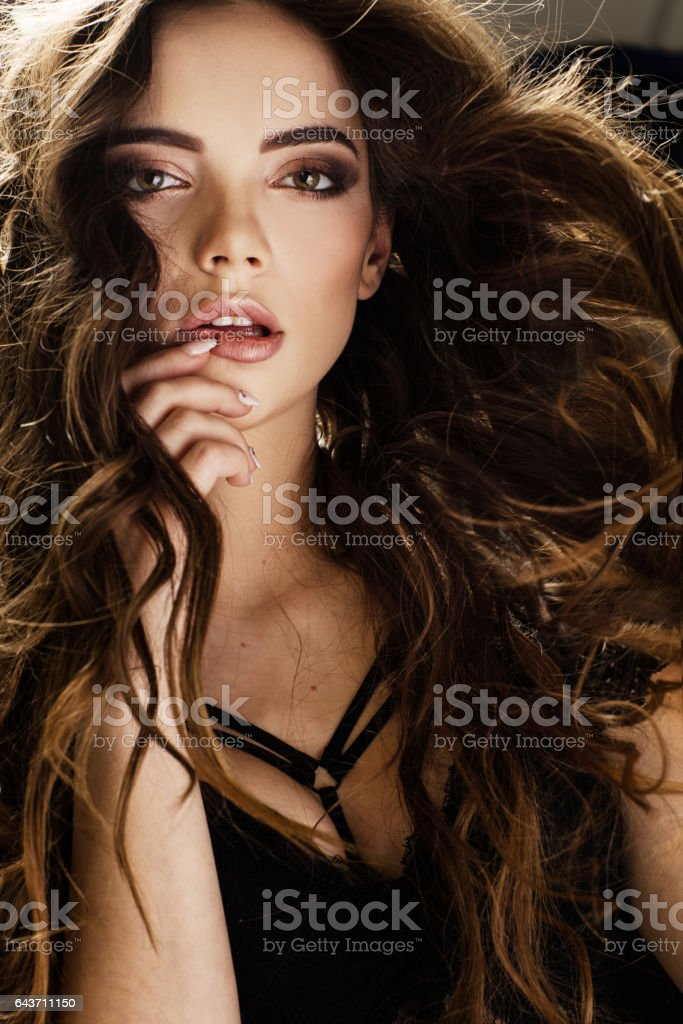 Portrait of sensual, curly hairs' women stock photo