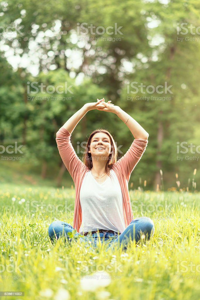 Portrait of sensual woman enjoying sunny spring day in nature stock photo