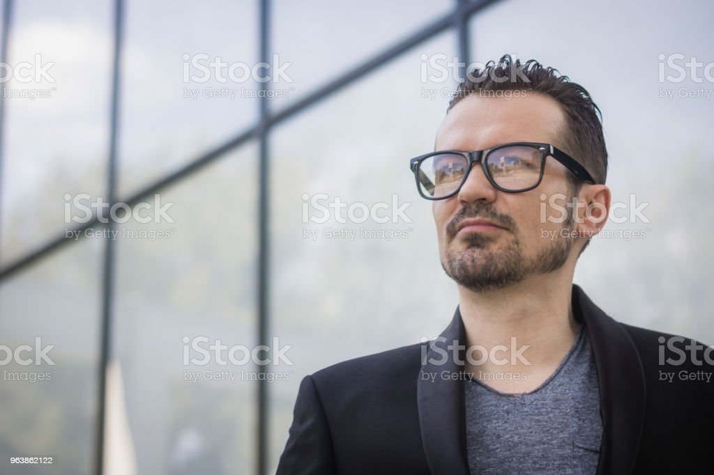 Portrait of serious businessman outdoors. - Royalty-free Adult Stock Photo