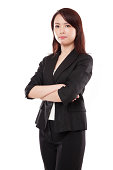 Young attractive Asian businesswoman with serious expression, isolated on white background.