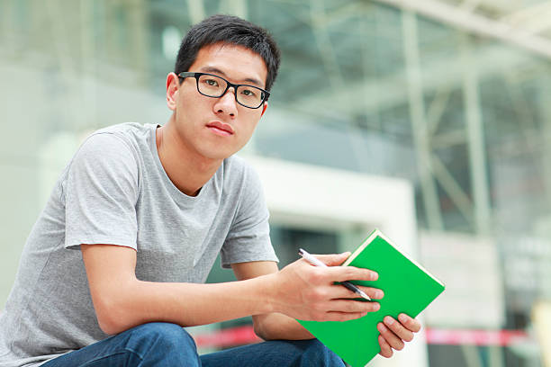 portrait of serious college student stock photo