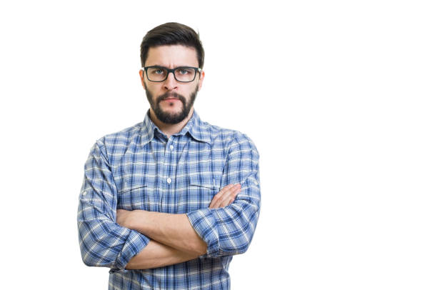 Portrait of serious confident young businessman with crossed arms on his chest stock photo