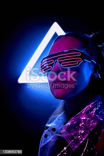 Determined woman in luminous goggles