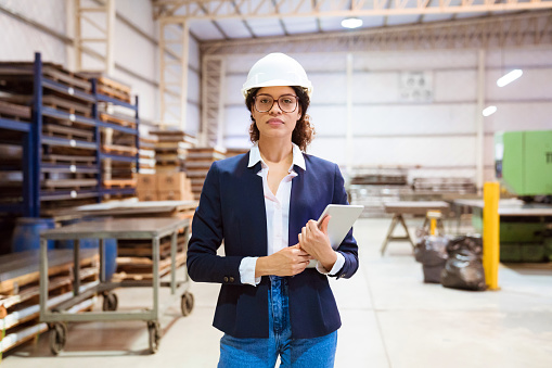 Portrait Of Serious Female Manager In Factory Stock Photo - Download Image Now
