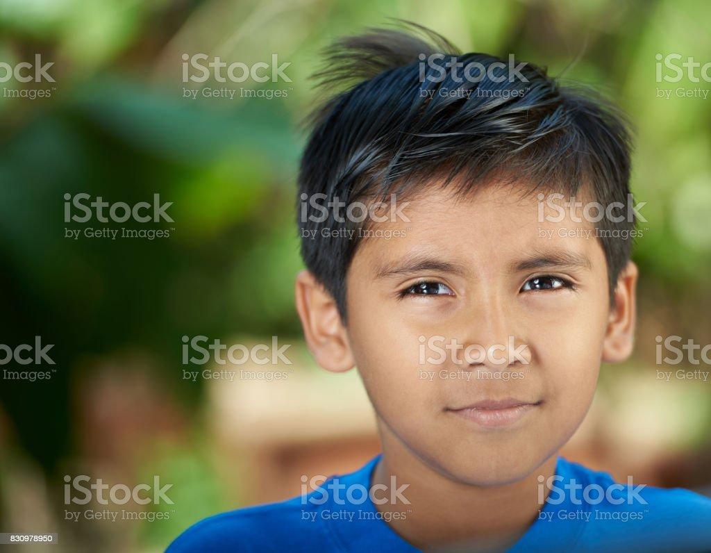 Portrait of serious hispanic boy stock photo