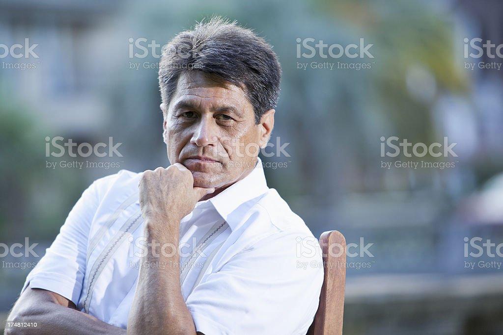 Portrait of serious Hispanic man stock photo