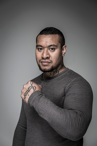 SYD11207: Portrait of serious macho young adult pacific islander man with tattoos