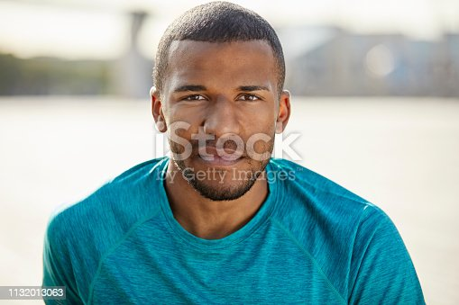 istock Portrait of serious man at park 1132013063