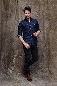 Portrait of serious man in denim shirt, studio