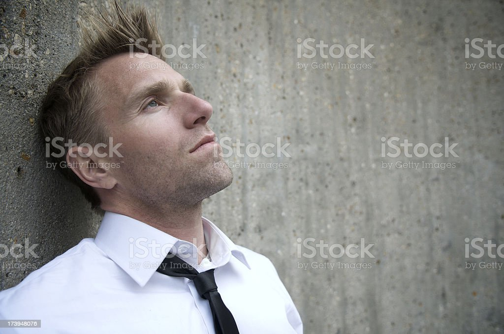 Portrait of Serious Man Outdoors Gray Wall royalty-free stock photo