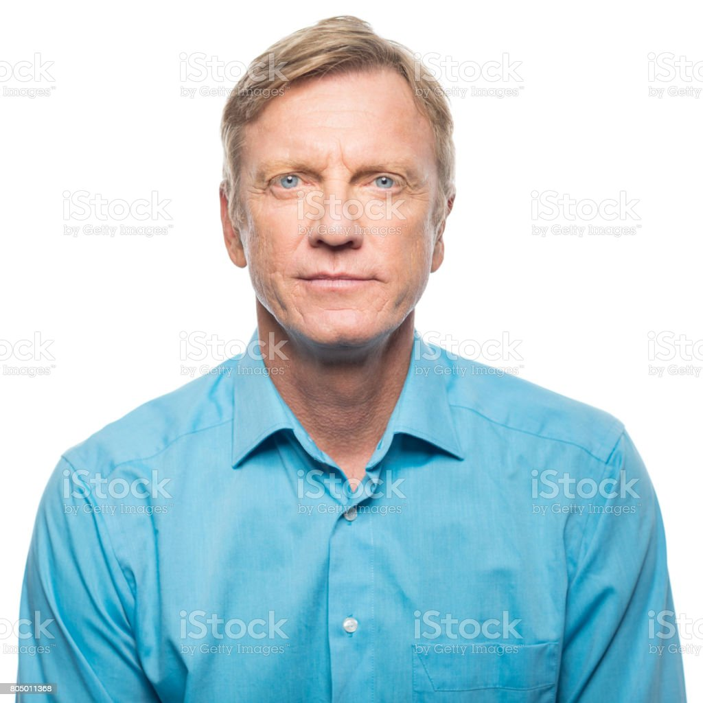 Portrait of serious mid adult man stock photo