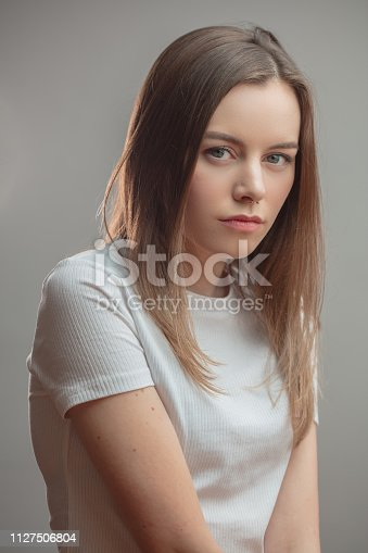 1126620182istockphoto portrait of serious nice female with piercing in the nose 1127506804