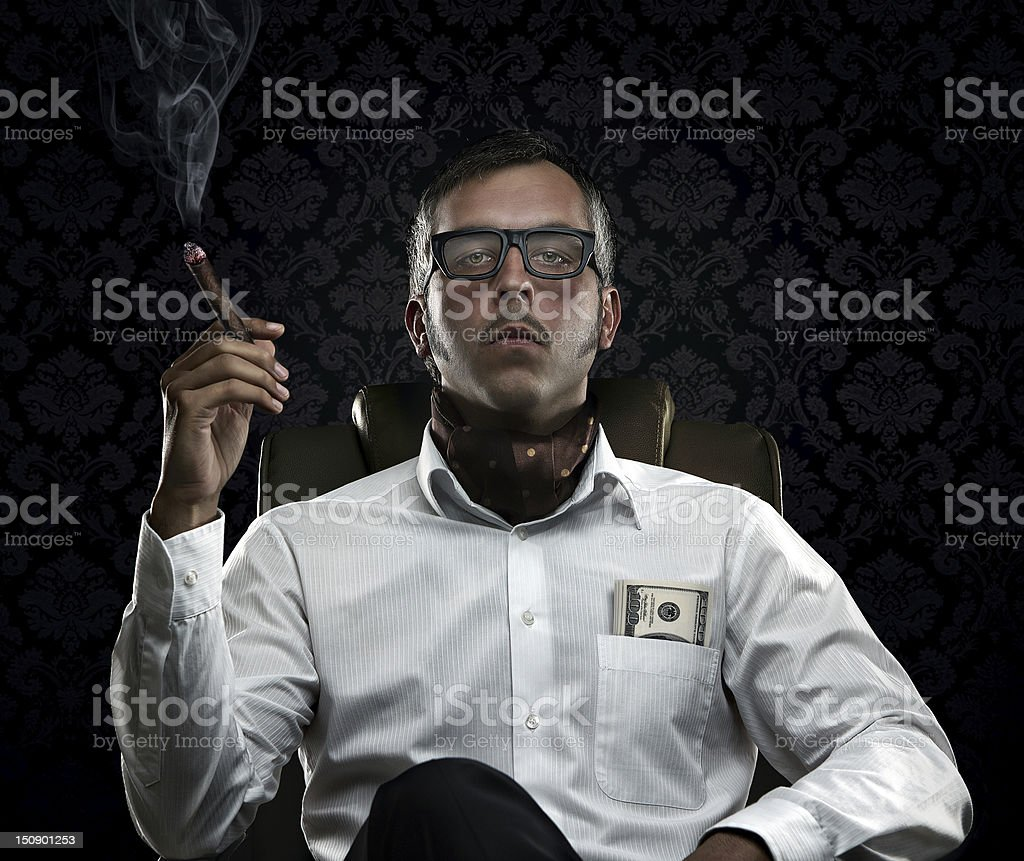 Portrait of serious rich man with money and cigar stock photo