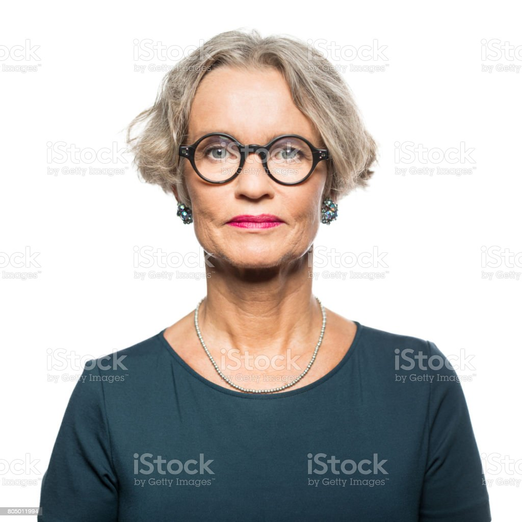 Portrait of serious senior woman stock photo