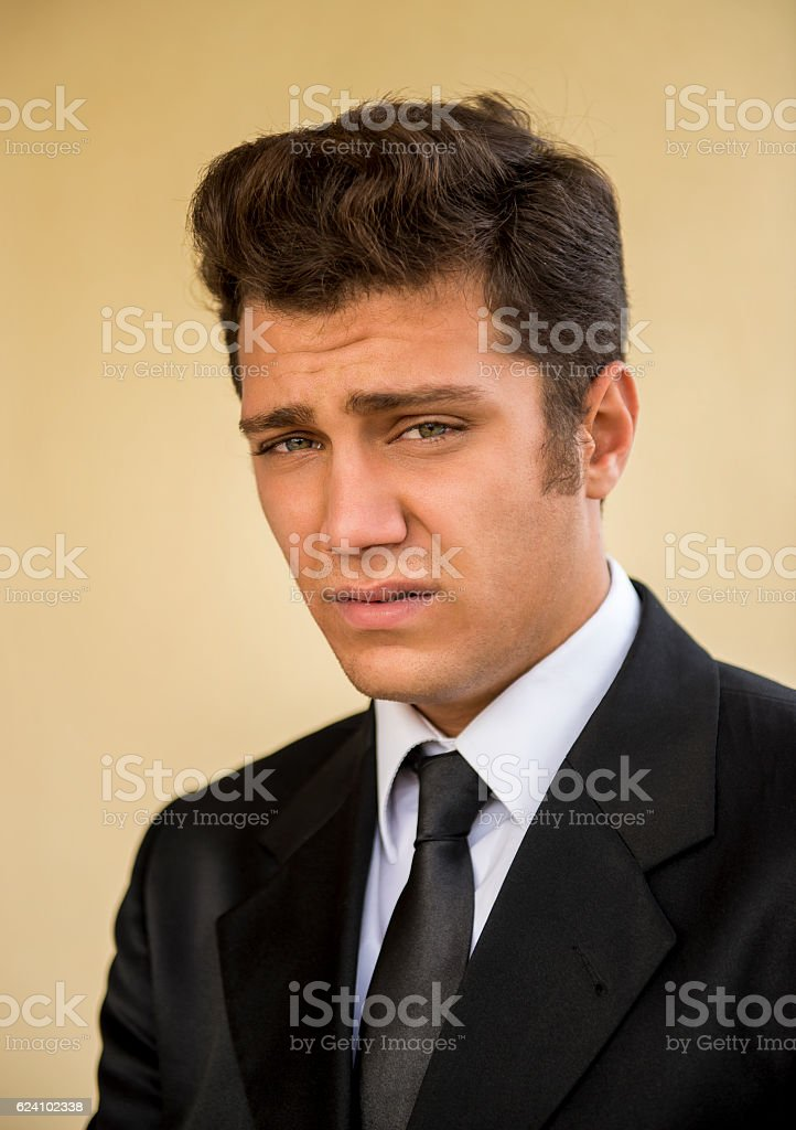 Portrait of serious young businessman looking at camera stock photo