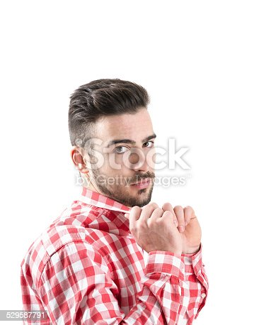 istock Portrait of serious young man holding collar looking at camera 529587791