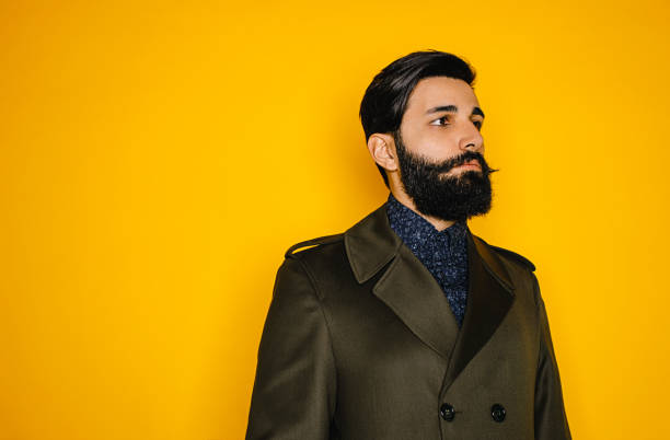portrait of serious young man with beard - mustache stock pictures, royalty-free photos & images