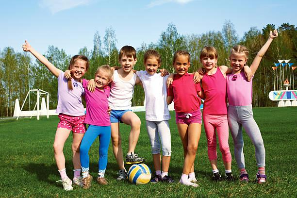 Portrait of seven little children with balls stock photo