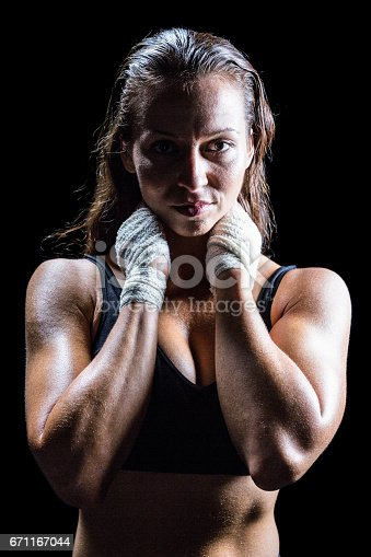 istock Portrait of sexy athlete with hands around neck 671167044