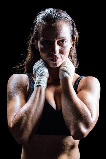 istock Portrait of sexy athlete with hands around neck 671167044