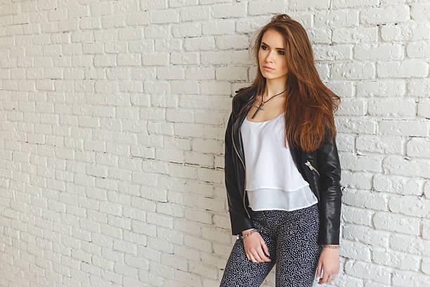 portrait of sexy beautiful young brunette woman in leather jacket - leder leggings stock-fotos und bilder