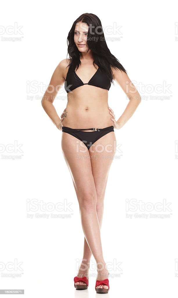 Portrait of sexy brunette in brown bikini isolated royalty-free stock photo