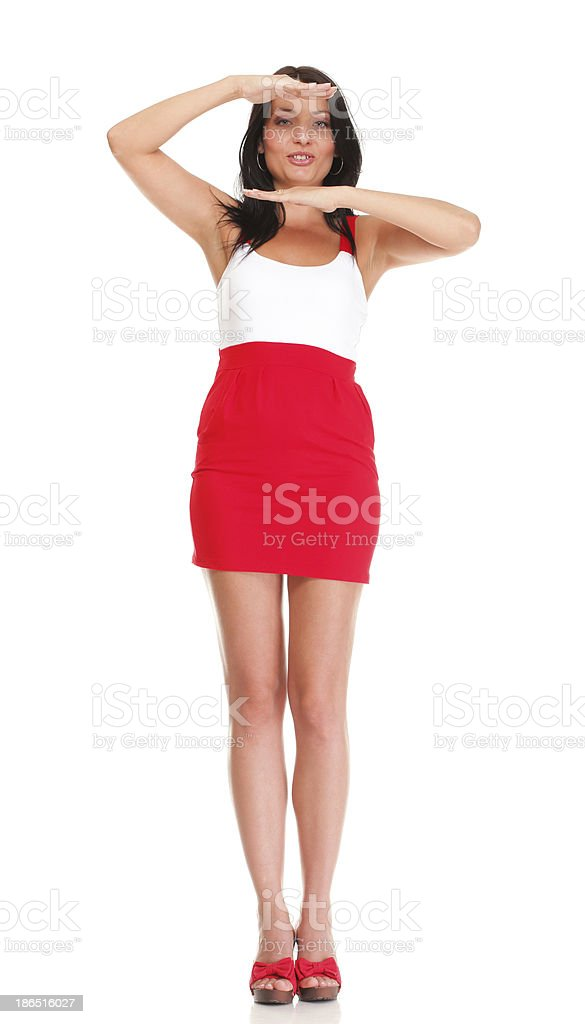 Portrait of sexy brunette in red white dress isolated royalty-free stock photo