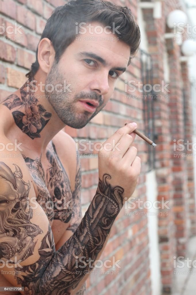 Portrait of sexy tattooed bearded man stock photo more for Bearded tattooed man